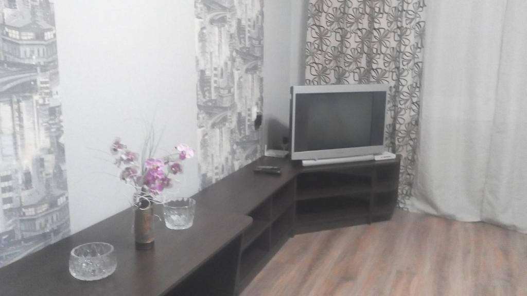Телевизор и/или развлекательный центр в Apartament Nikitenko III