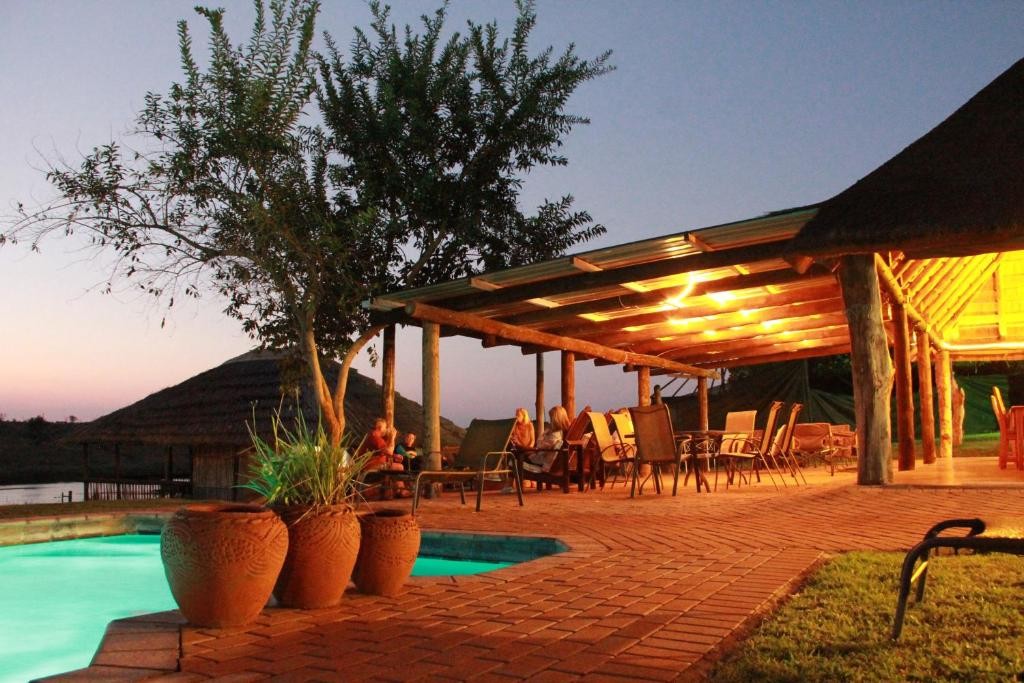 The swimming pool at or near Crocodile Bridge Safari Lodge