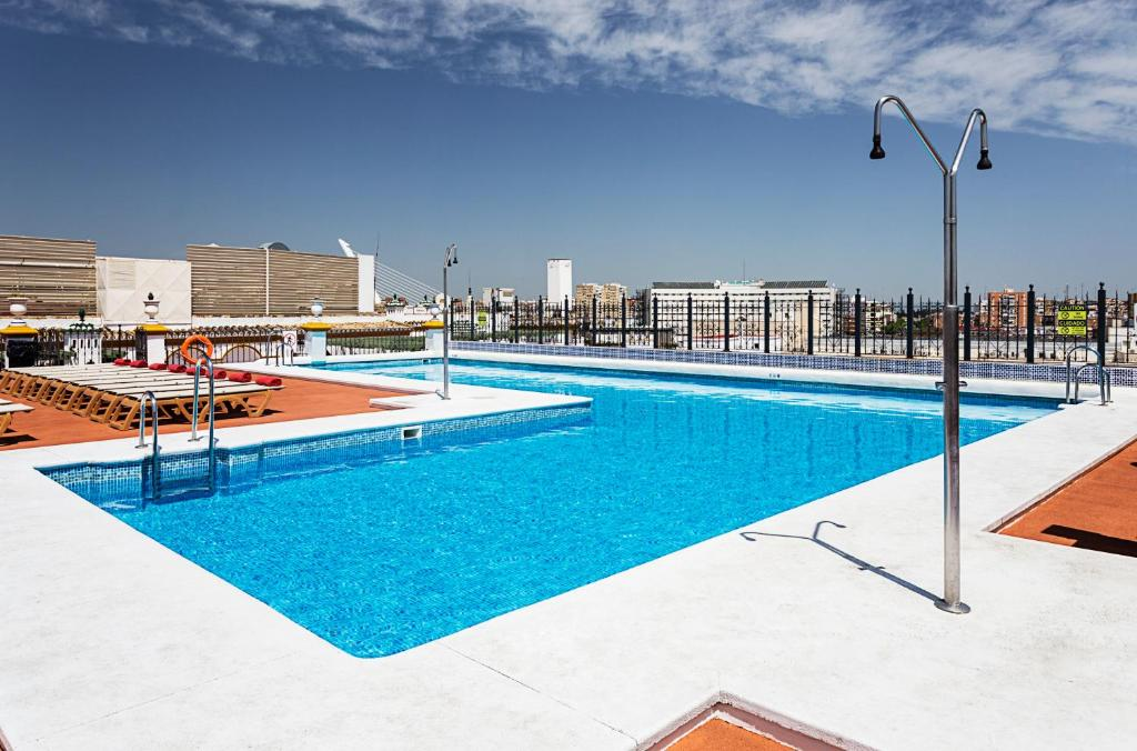 The swimming pool at or near Exe Sevilla Macarena