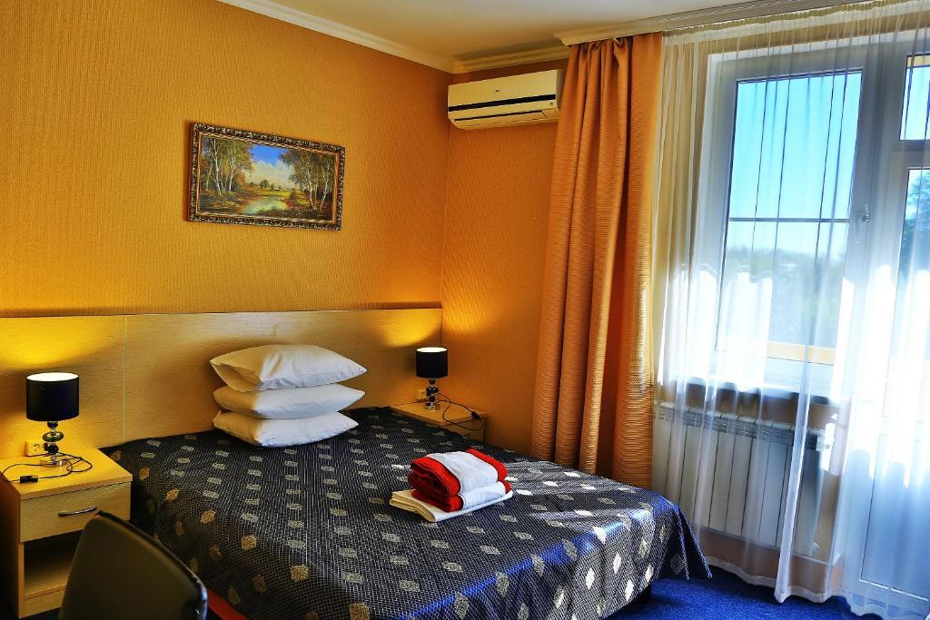 Кровать или кровати в номере Мини-отель Сибирь
