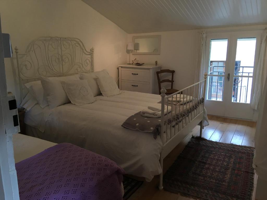 Un ou plusieurs lits dans un hébergement de l'établissement B&B at no3