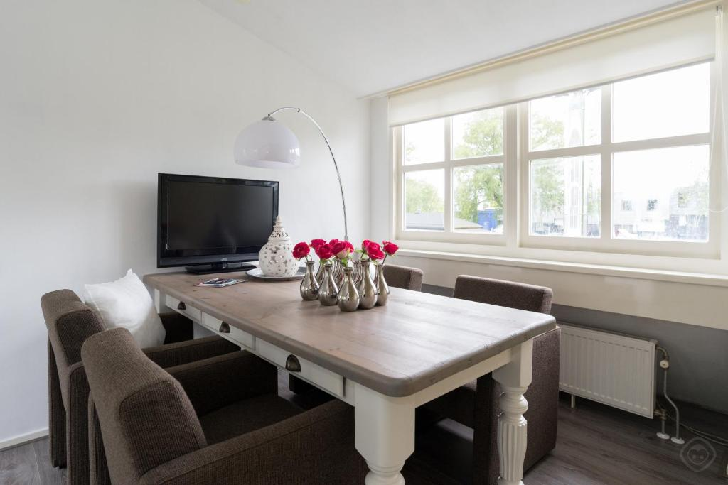 A television and/or entertainment center at Idyllic Sloten apartment