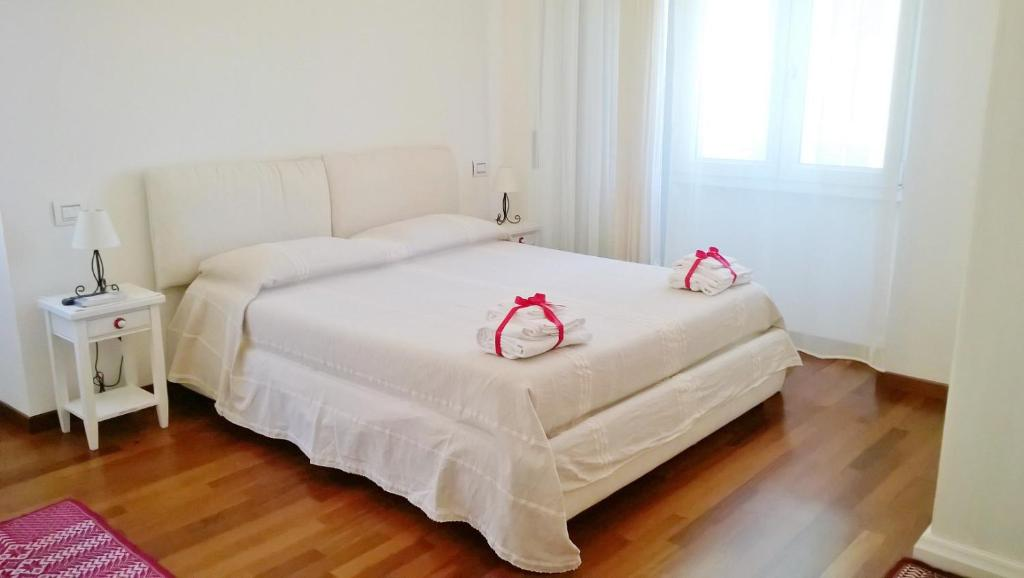 A bed or beds in a room at B&B San Carlo