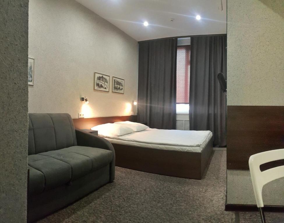 Кровать или кровати в номере Отель Релакс