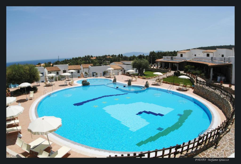A view of the pool at Hotel Nuraghe Arvu or nearby