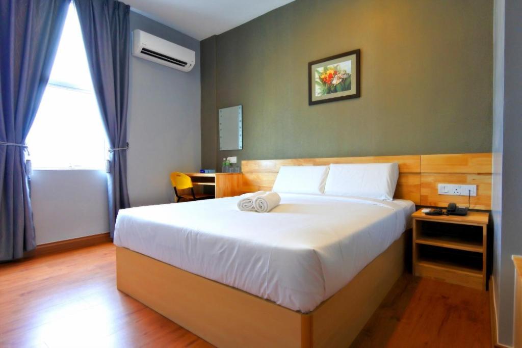 Katil atau katil-katil dalam bilik di Hotel Dutaria