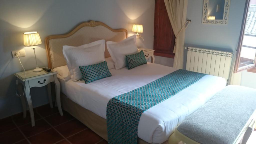 Cama o camas de una habitación en Casa Rural El Gaiter