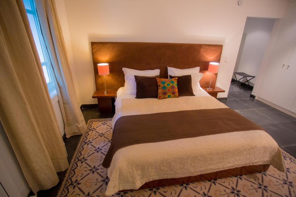A bed or beds in a room at Quinta Do Convento