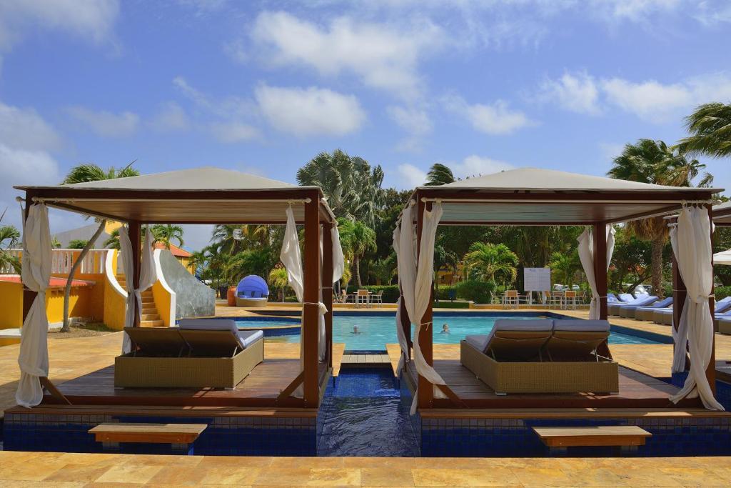 The swimming pool at or near All Inclusive Divi Flamingo Beach Resort