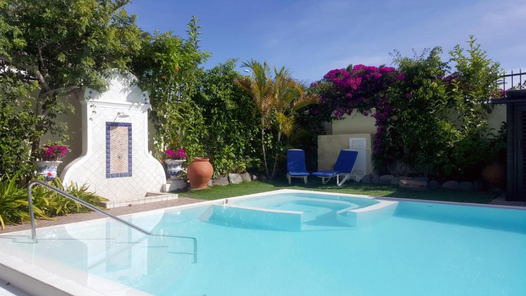 The swimming pool at or near VIP Apartamentos Nogal- Adults Only