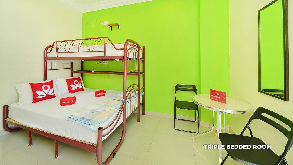 A bunk bed or bunk beds in a room at ZEN Hostel Serangoon Road