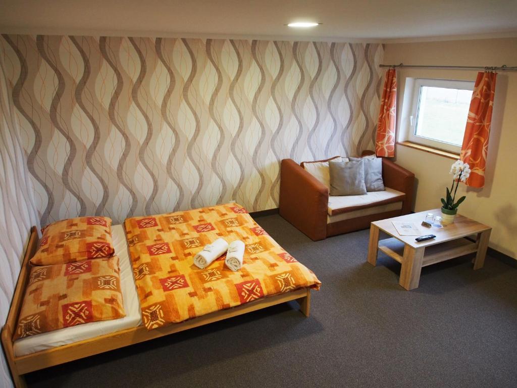 Łóżko lub łóżka w pokoju w obiekcie Pension Růžák