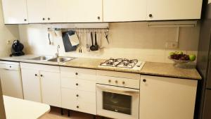 Kuchyň nebo kuchyňský kout v ubytování Platja d´Aro Bungalow