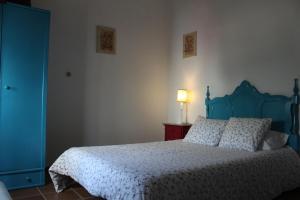 Uma cama ou camas num quarto em Cardenha