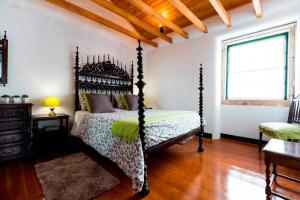 A bed or beds in a room at Atelier - House in Belém