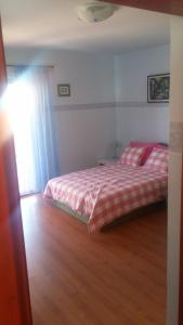 A bed or beds in a room at Villa Sole