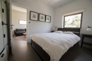 A bed or beds in a room at Boutique Home