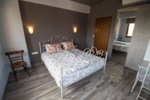 A bed or beds in a room at Harmony Deluxe Villas