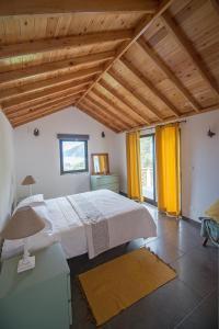 Cama o camas de una habitación en Casa do André (Casas do Capelo)