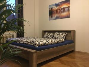 Ein Bett oder Betten in einem Zimmer der Unterkunft Tomas Apartment