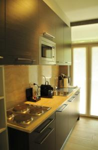 A kitchen or kitchenette at Le Tissu Résidence