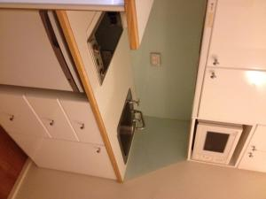 A kitchen or kitchenette at Knightsbridge Apartments