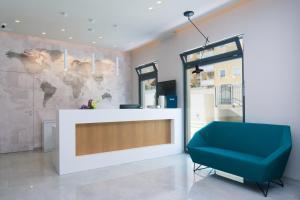 The lobby or reception area at Aparthotel Punta Blu