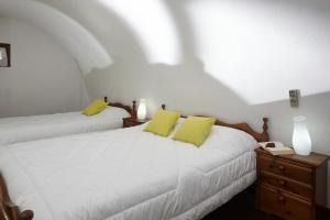 Ein Bett oder Betten in einem Zimmer der Unterkunft Anna Traditional Apartments