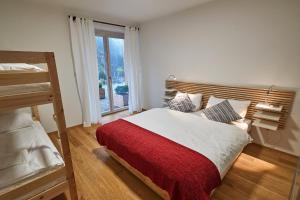 Ein Bett oder Betten in einem Zimmer der Unterkunft Kovárna Residence
