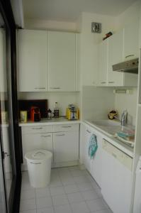 A kitchen or kitchenette at Un Coin de Paradis