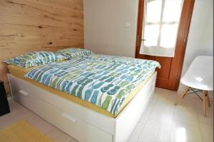 A bed or beds in a room at Apartments Nac Bovec