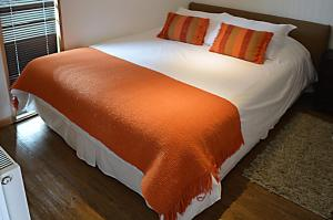 A bed or beds in a room at Apart Hotel Quillango