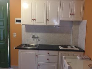 Η κουζίνα ή μικρή κουζίνα στο Georgakis George Rooms