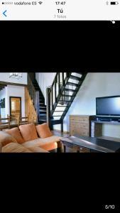 Una televisión o centro de entretenimiento en Casa en el Palmar