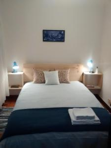A bed or beds in a room at Vigo Excursions