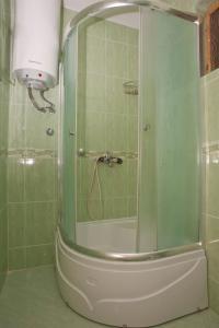 A bathroom at Apartment and Studio Giljaca