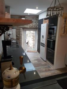 Cuisine ou kitchenette dans l'établissement Gite De Charme