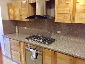 A kitchen or kitchenette at Apt 1-C Las Dallias II, Bella Vista