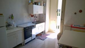 A kitchen or kitchenette at Annelisa Appartamento vacanze