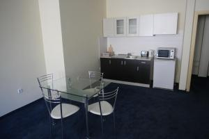 A kitchen or kitchenette at VIP-Rent Apartments