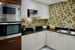 A kitchen or kitchenette at Marriott Executive Apartments Addis Ababa