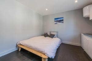 Un ou plusieurs lits dans un hébergement de l'établissement Studio Neige - ANNECY DREAM