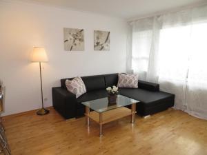 A seating area at Apartment Hbf Salzburg