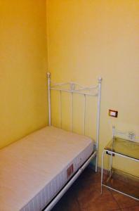Postel nebo postele na pokoji v ubytování Residence La Sorgente