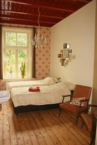 Een bed of bedden in een kamer bij BuitenOosten