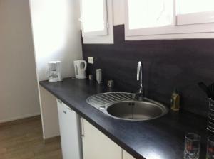 Cuisine ou kitchenette dans l'établissement Charmant Appartement Lorraine