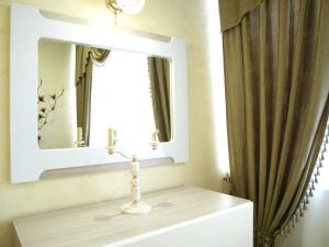 A bathroom at Comfort Apartments on Lermontova 19A, №3