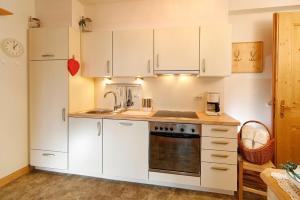 A kitchen or kitchenette at Residence Haus Dornsberg