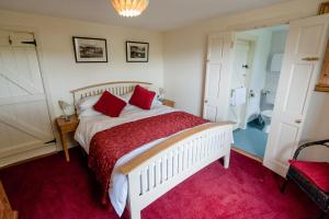 A bed or beds in a room at The Wild Atlantic Hideaway