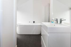A bathroom at Charming Inner City Holiday Home